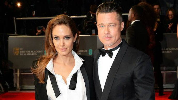 Brad-Pitt-in-Valentino-and-Angelina-Jolie-Saint-Laurent  Best Dressed Celebrities on BAFTAs 2014 Brad Pitt in Valentino and Angelina Jolie Saint Laurent